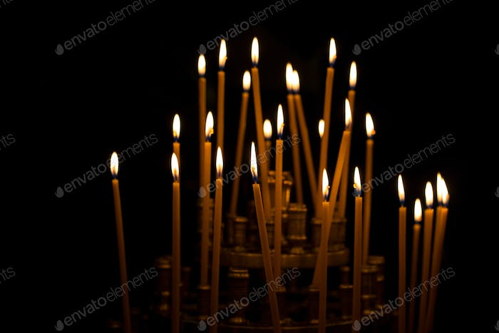 burning candles in a church, easter or memorial