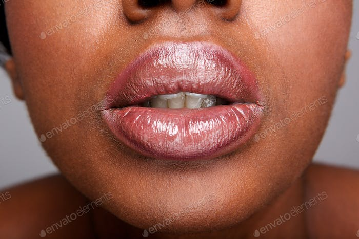 Close up beautiful african american woman with shiny lip gloss
