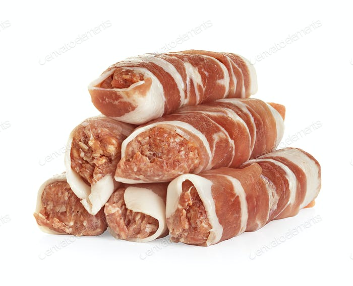 sausages wrapped in bacon, chevapchichi isolated on white background