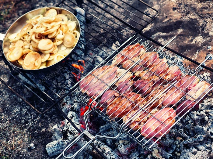 Grilled meat and a frying pan with a bow
