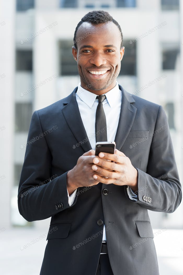 Businessman with mobile phone.