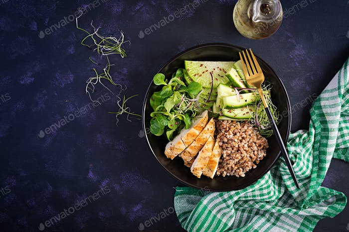 Lunch salad. Buddha bowl with buckwheat porridge, grilled chicken fillet, corn salad