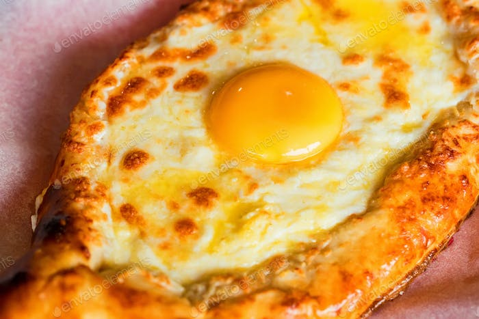 Ajarian khachapuri Georgian cheese pie with egg close