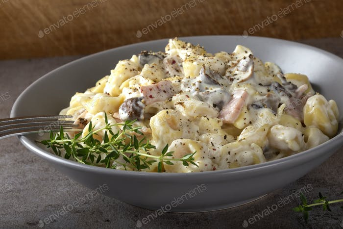 Ravioli with mushrooms and ham