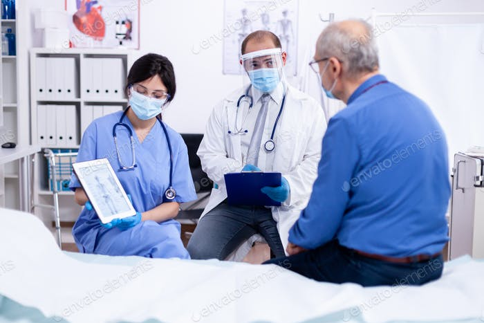 Senior man suffering of osteoporosis