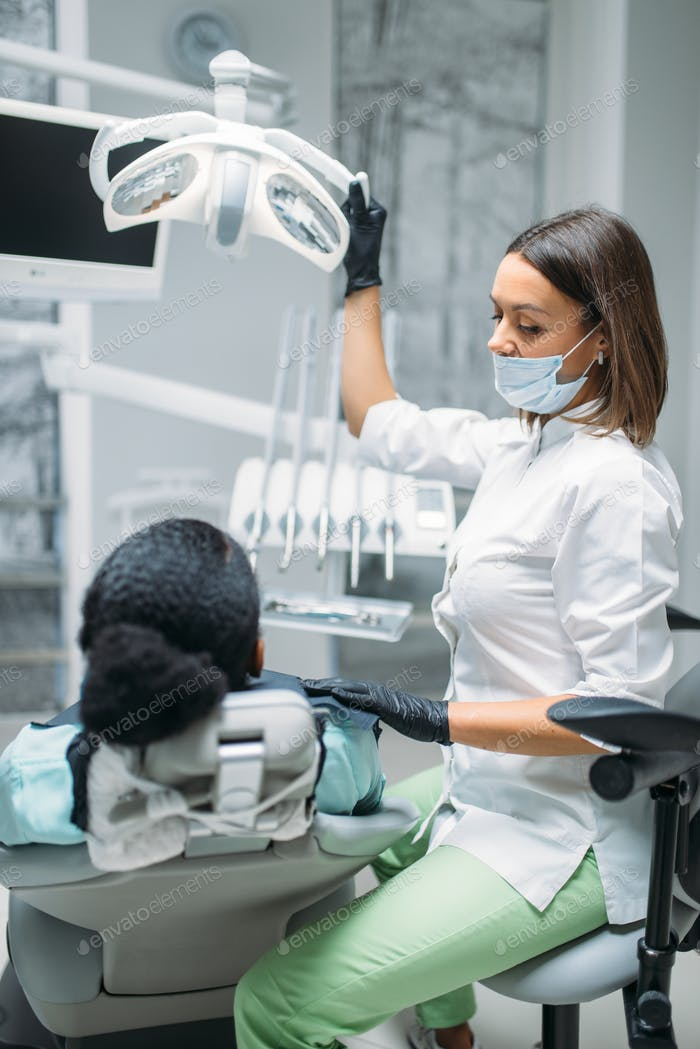 Dentist in mask and gloves, dental clinic