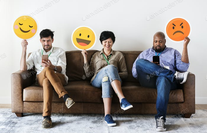 Diverse people sitting and holding emojis logos
