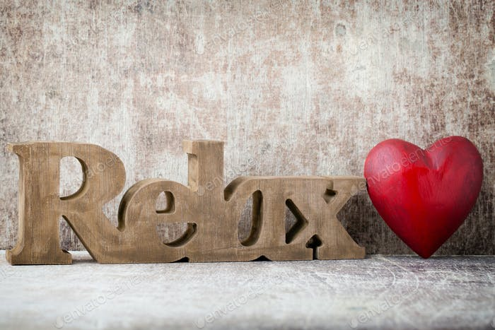 Relax. Message of home with wooden letters.
