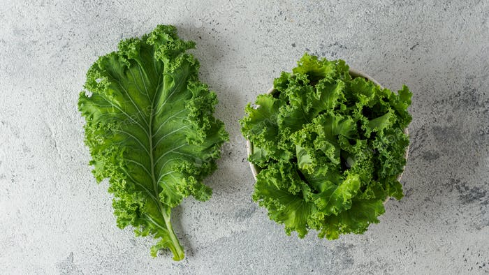 Green kale leaf and salad, top view