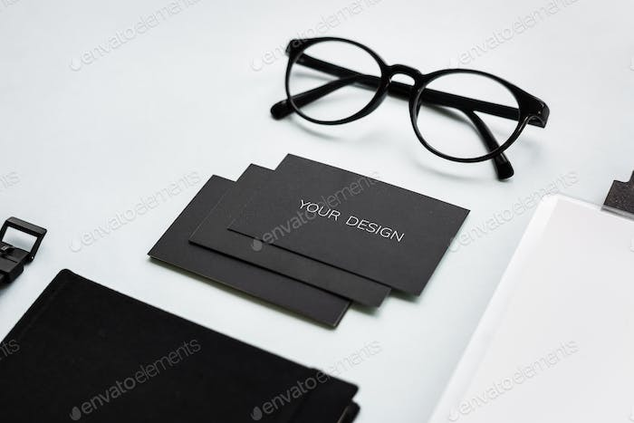 Closeup of black paper cards with eyeglasses on table