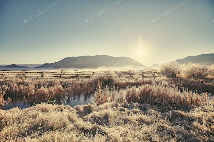 Retro toned frosty sunrise at Grand Teton National Park.