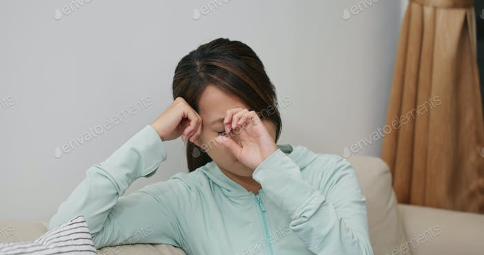 Woman feel headache at home