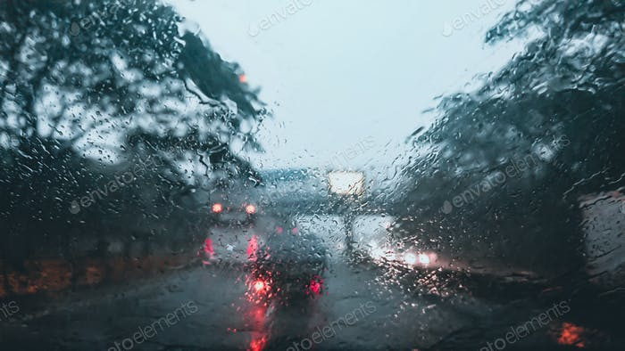 Car windshield with heavy rain background