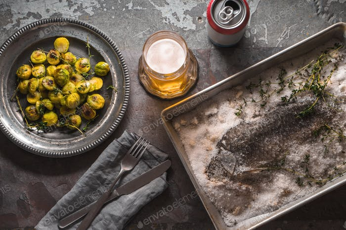 Sill life with fish , Brussels sprouts and beer