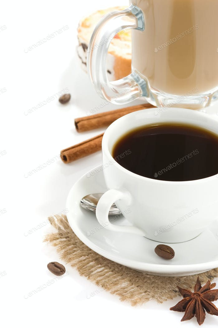 cup of coffee with beans and sweets isolated on white