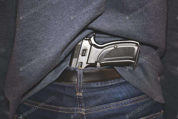 Handgun under belt