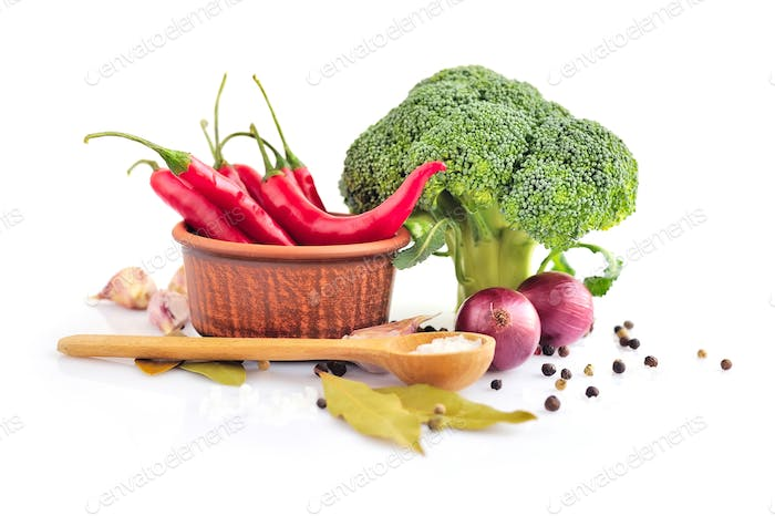 Vegetables and spices on a white background