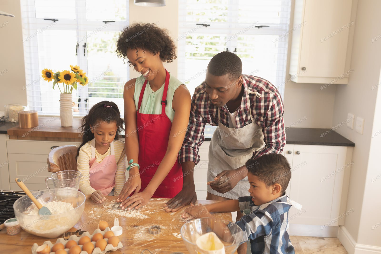High angle view of African American family baking cookies in kitchen at  home photo by Wavebreakmedia on Envato Elements