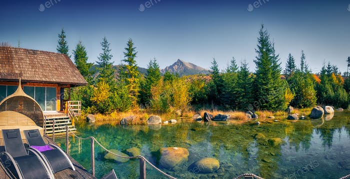 Autumn landscape panorama with spa, mountain peak and a lake, Krivan, Vysoke Tatry, Slovakia