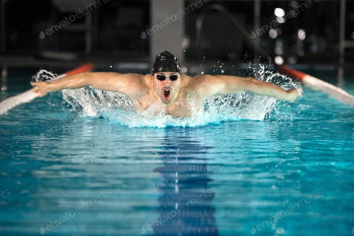 Young male swimmer swimming the butterfly stroke