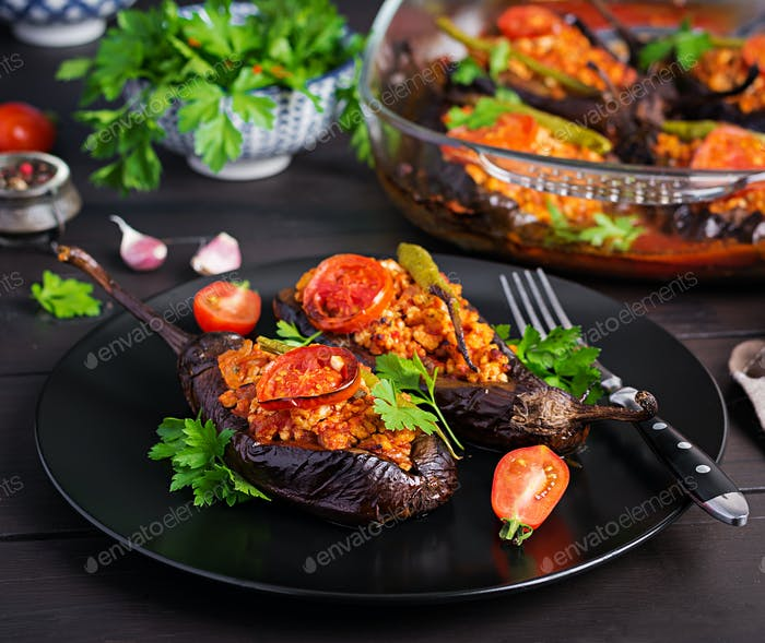 Karniyarik - turkish traditional aubergine eggplant meal. Stuffed eggplants with ground beef