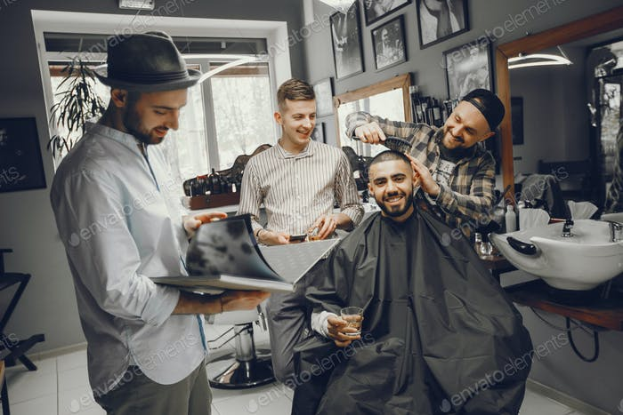 Friends have fun in barbershop