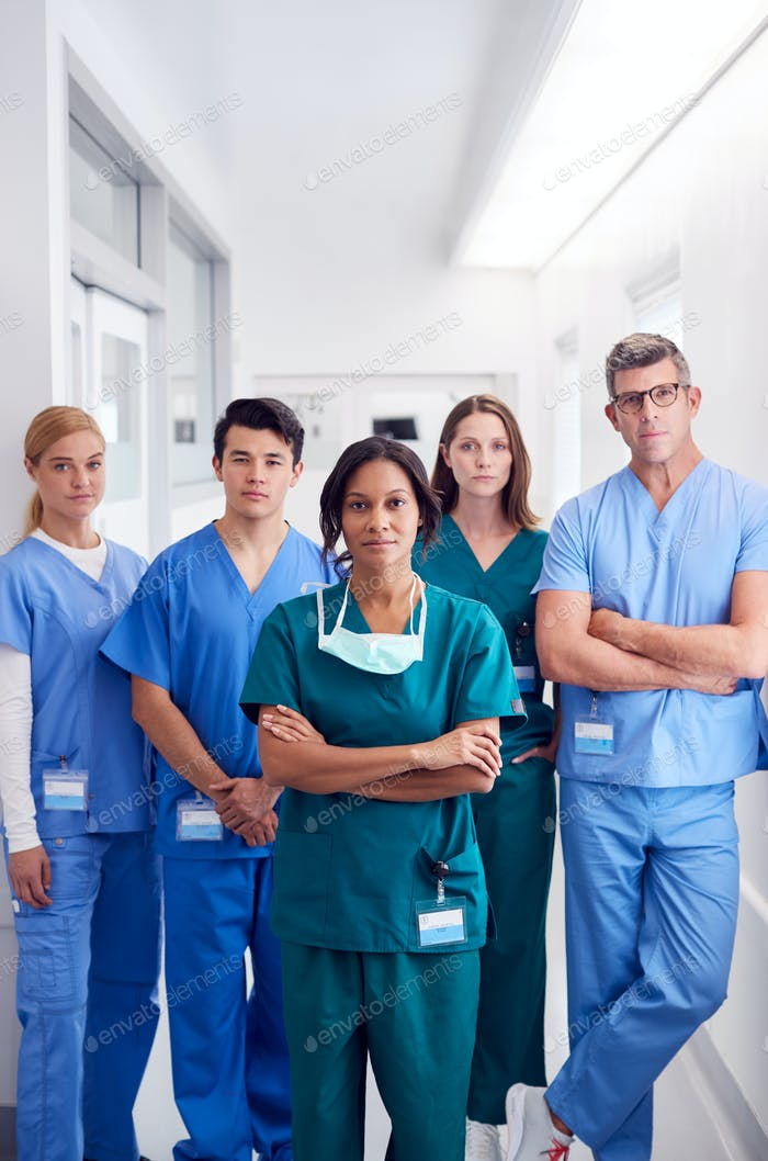 Portrait Of Multi-Cultural Medical Team Standing In Hospital Corridor