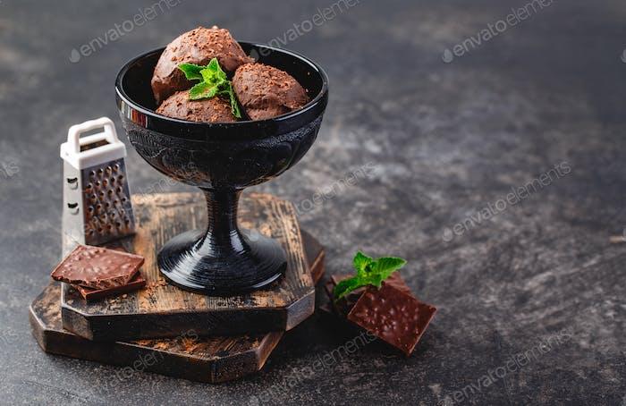 Three brown chocolate ice cream balls