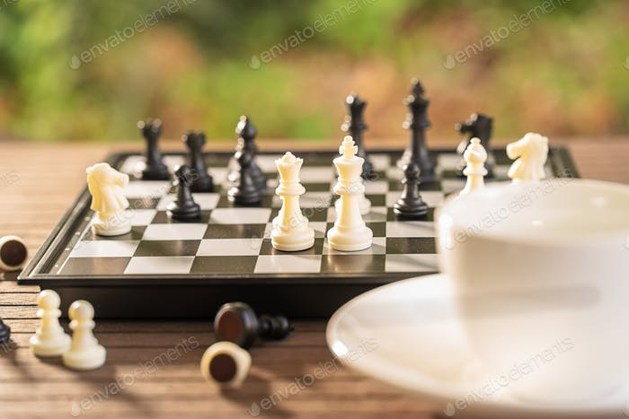 Coffee cup on wood table with Chess board-5