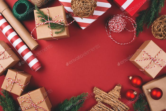 Red Background with Christmas Gifts and Decorations.