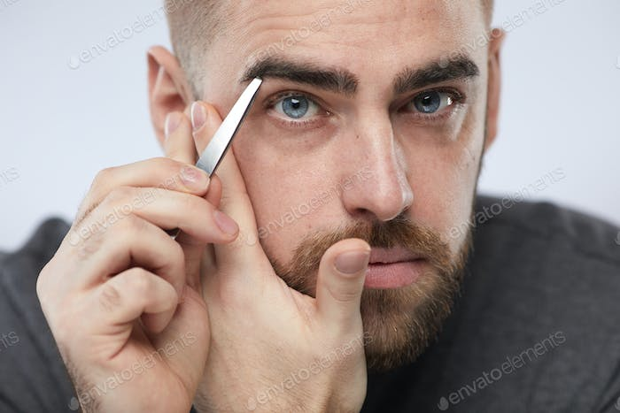 Man Shaping Eyebrows Portrait
