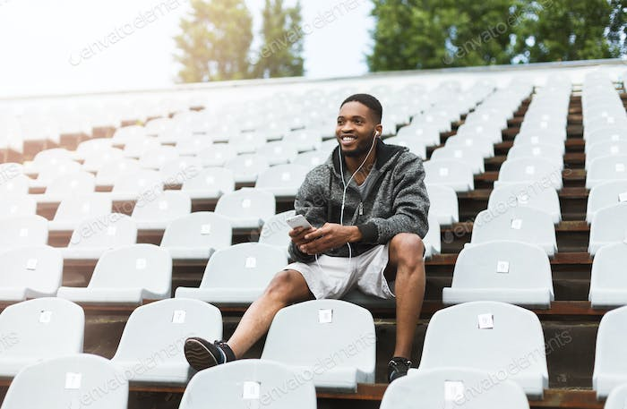 Relaxing man on stadium