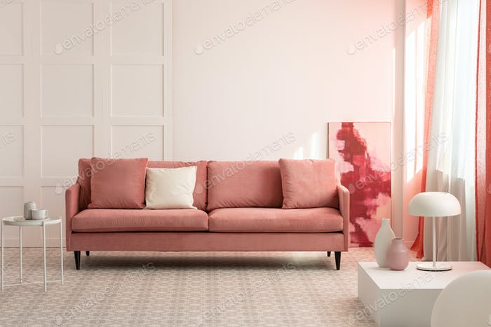 Pillows on comfortable sofa in bright living room interior