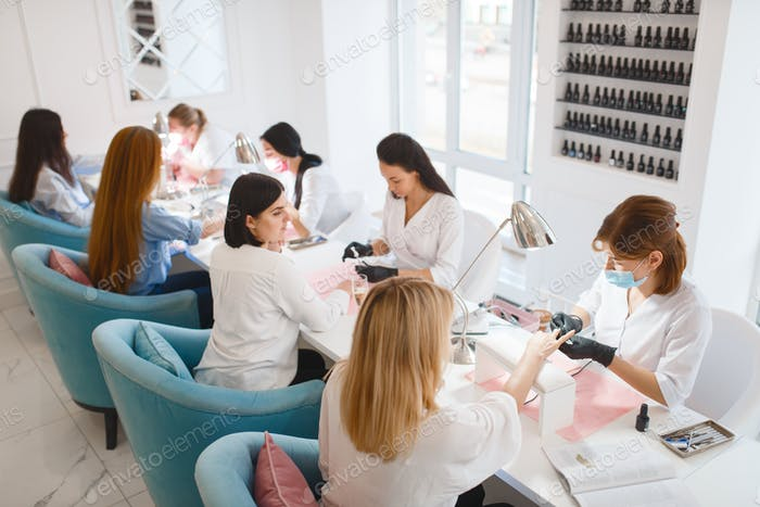 Group of girlfriends, manicure in beauty salon