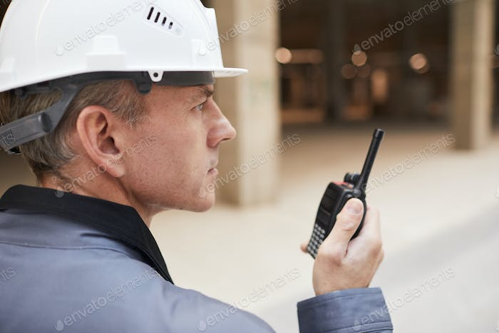 Construction Worker Speaking by Portable Radio