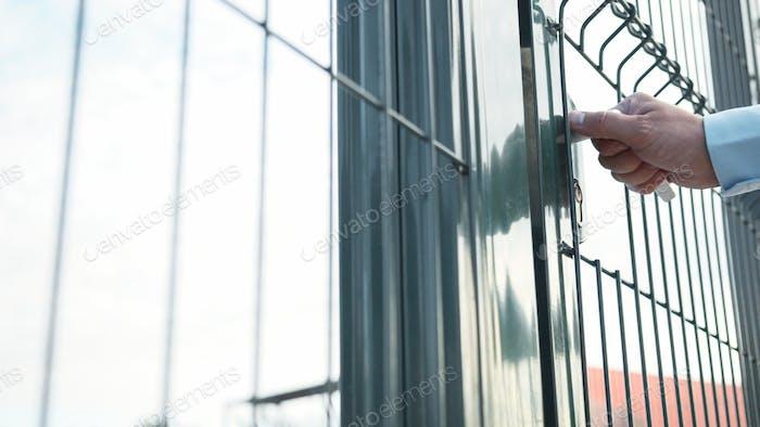 Male hand opening the door