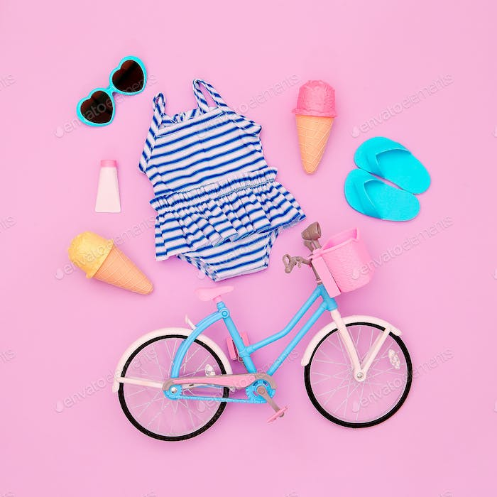 Vacation beach set. Ice cream, flip-flop, sunglasses, swimsuit, bicycle. Minimal flat lay