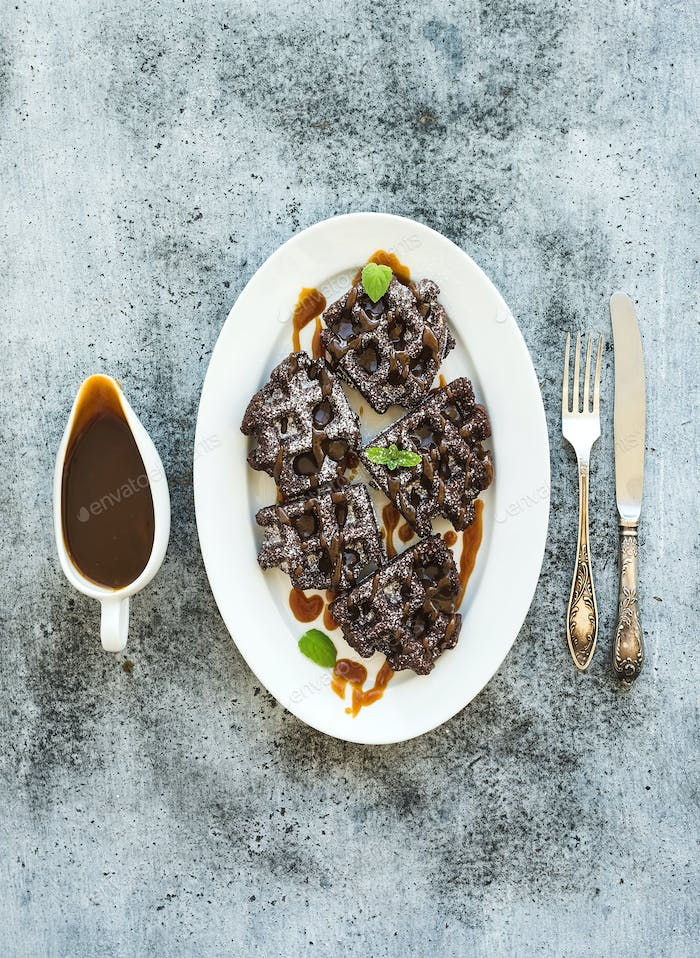 Chocolate Belgian waffles with salted caramel sauce and mint