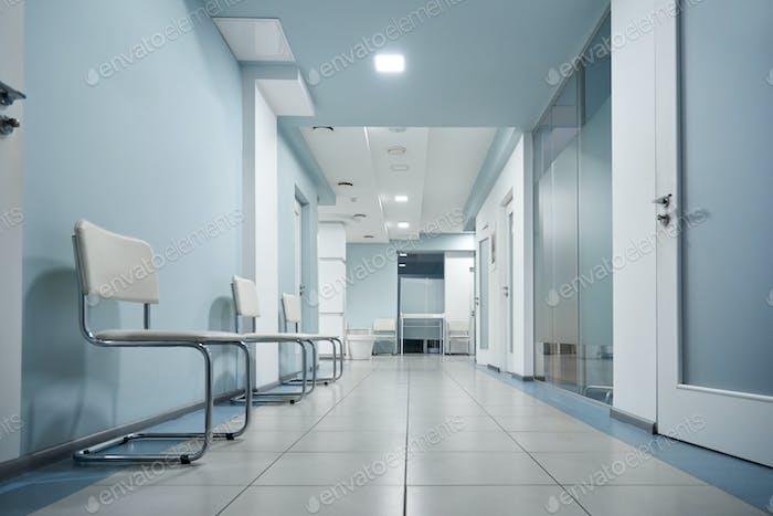 Empty modern hospital corridor, clinic hallway interior background.