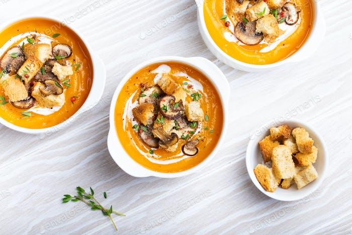 Pumpkin cream soup in bowls