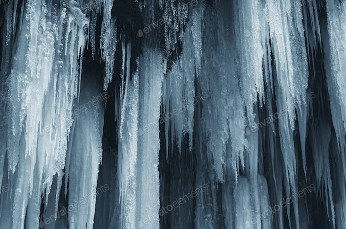Frozen waterfall in cold winter ice background