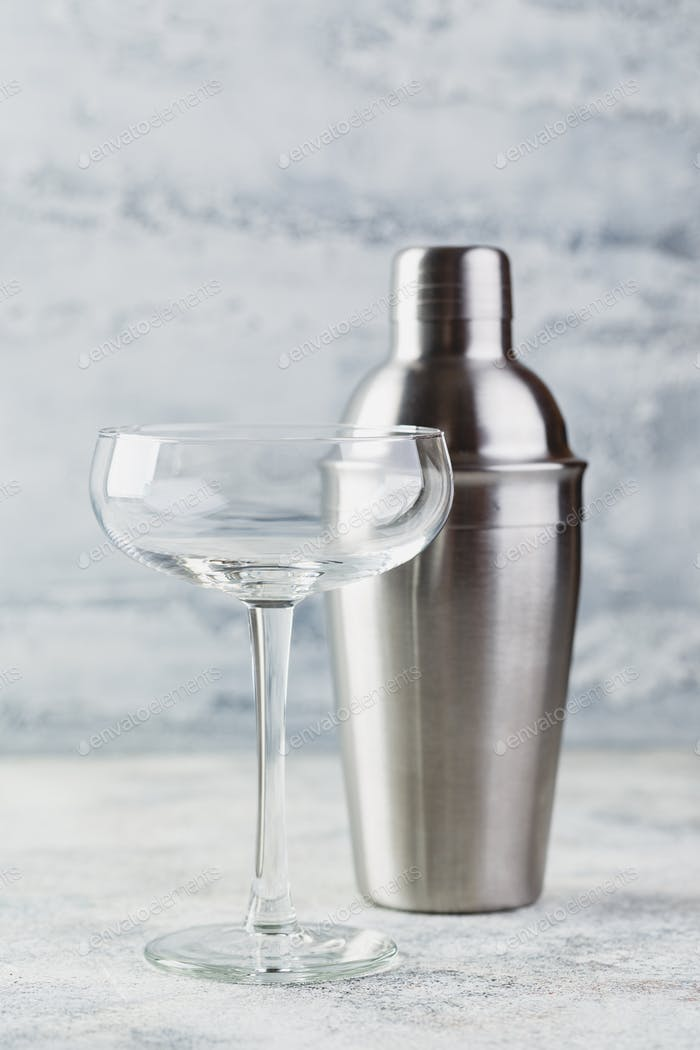 Empty champagne glass and metal shaker