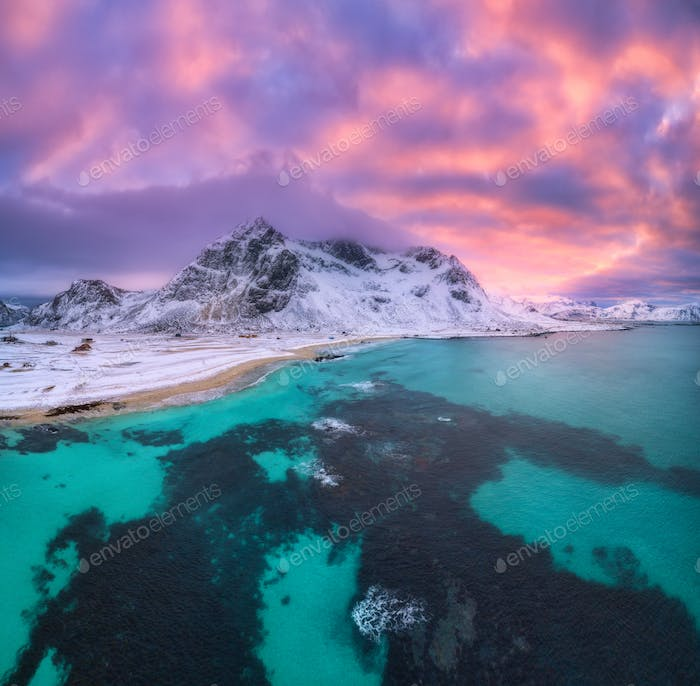 Nordic sandy beach with blue sea in winter at sunset. Aerial view
