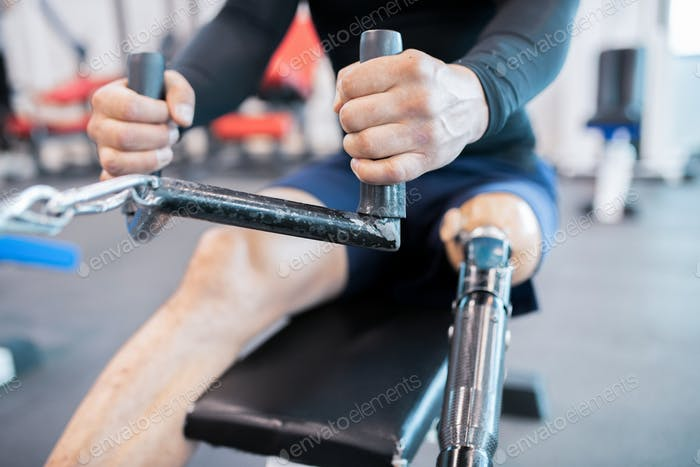 Adaptive Athlete Using Rowing Machine Close up