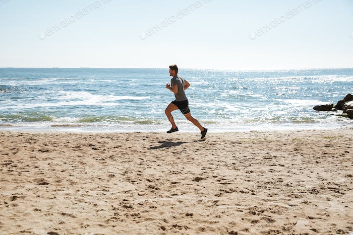 Strong young sportsman jogging