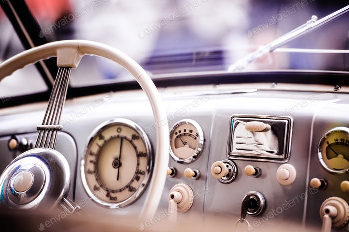 Close up of veteran car, dashboard, windshield, steering wheel