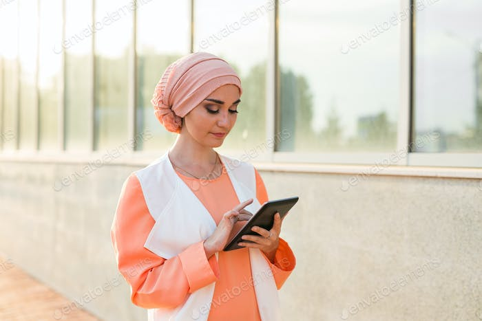 beautiful arabian girl with tablet computer