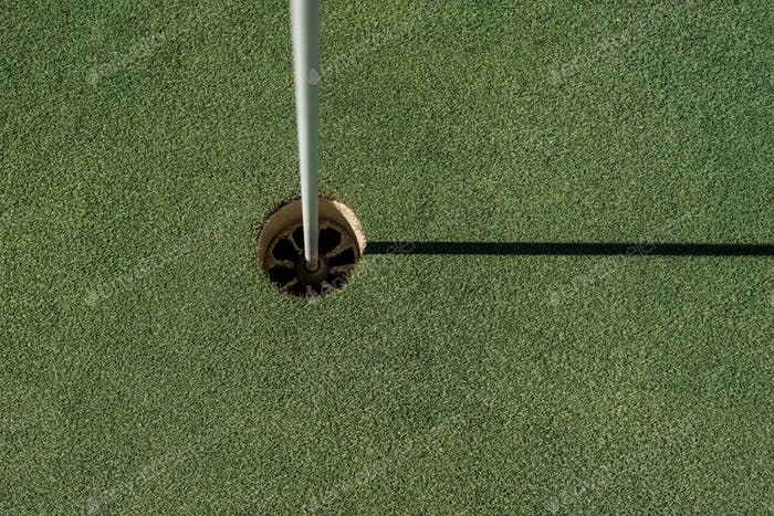 Golf field with empty hole