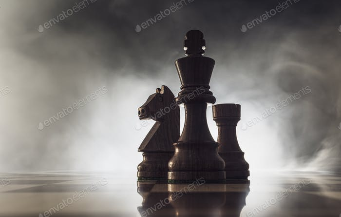 Chess game pieces and smoke