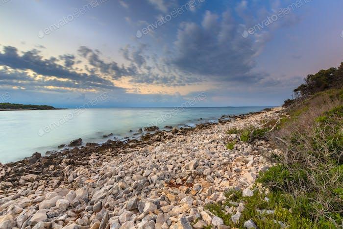 Sunrise over rocky coast on Cres